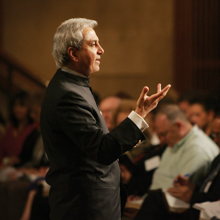 Pastor Benny Hinn teaching at conference
