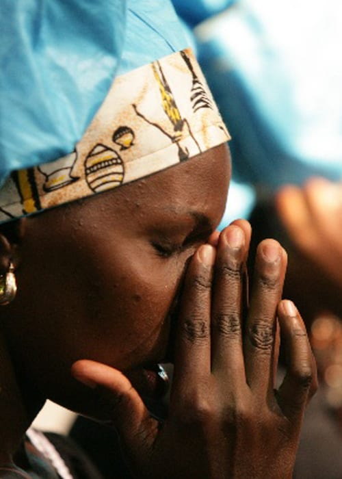African lady worshiping at Benny Hinn Ministries Event